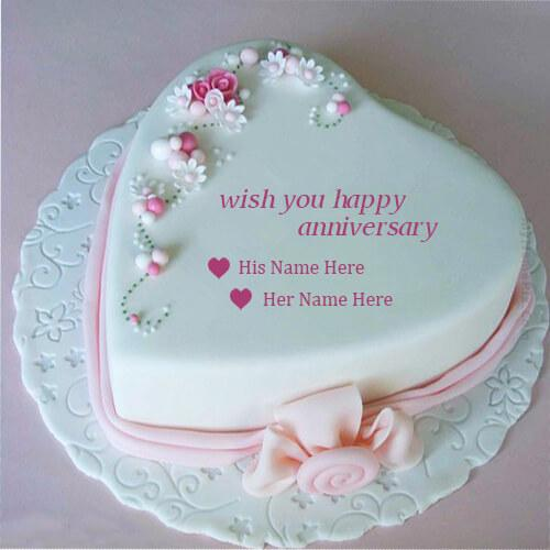 write couple name on beautiful pink heart anniversary cake